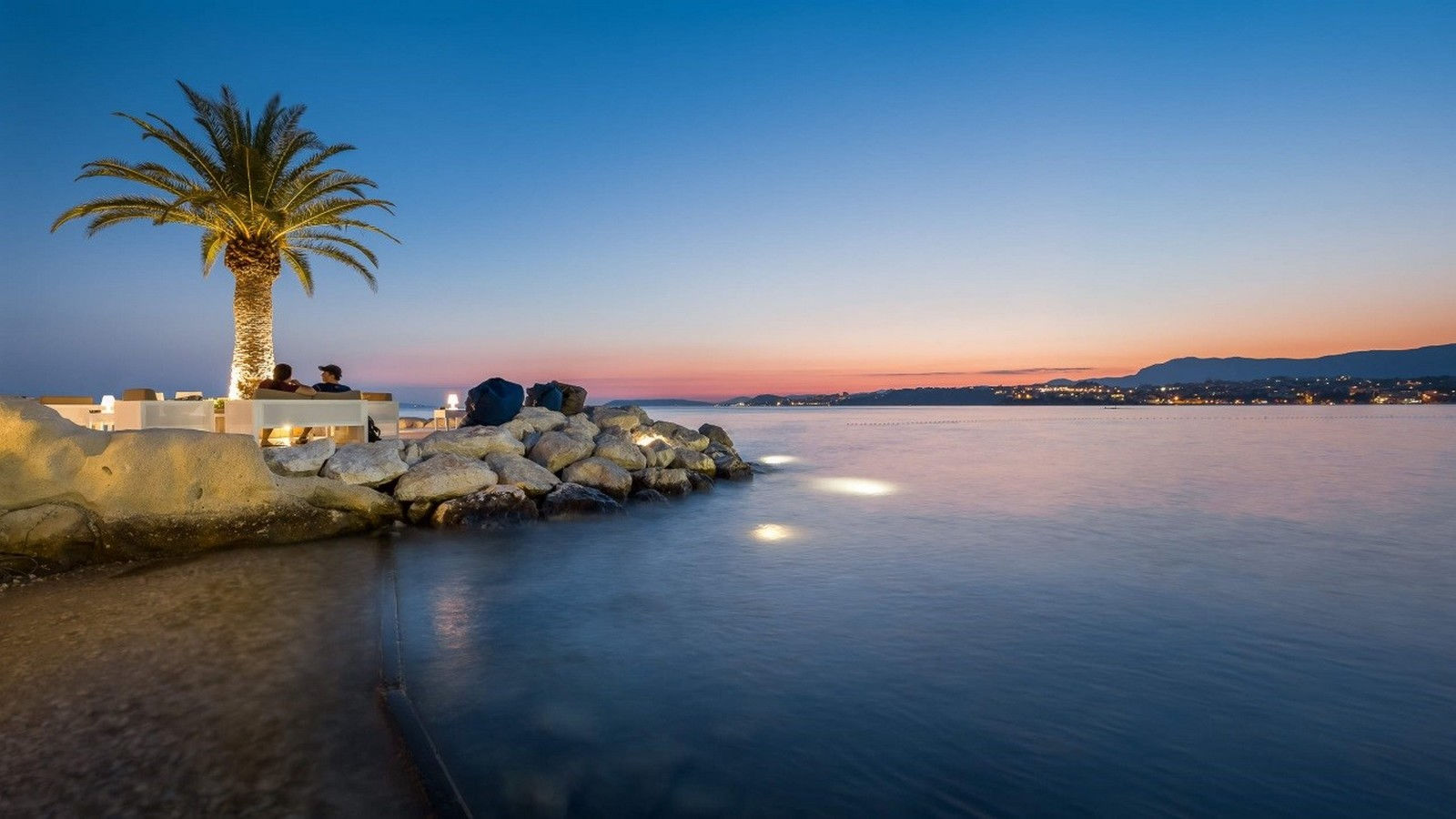 BY THE BEACH AND WATCH THE SUN SETTING OVER THE CALM WATERS OF THE ADRIATIC SEA